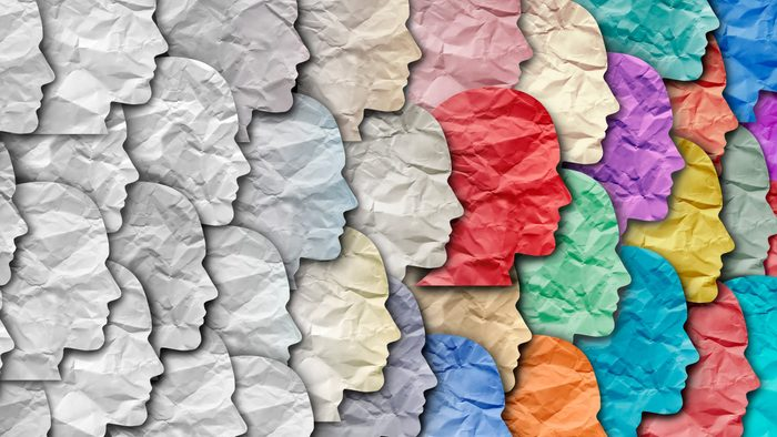 paper faces that fade from white to full color