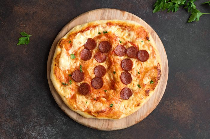 Pi Day Pizza. Homemade Pepperoni and Cheese Pizza for Pi Day Event, top view. Pepperoni positioning forms a pi symbol.