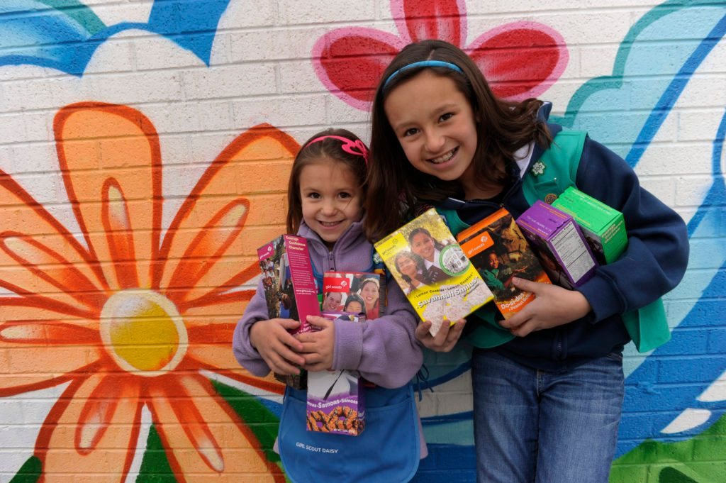 sisters sell girl scout cookies