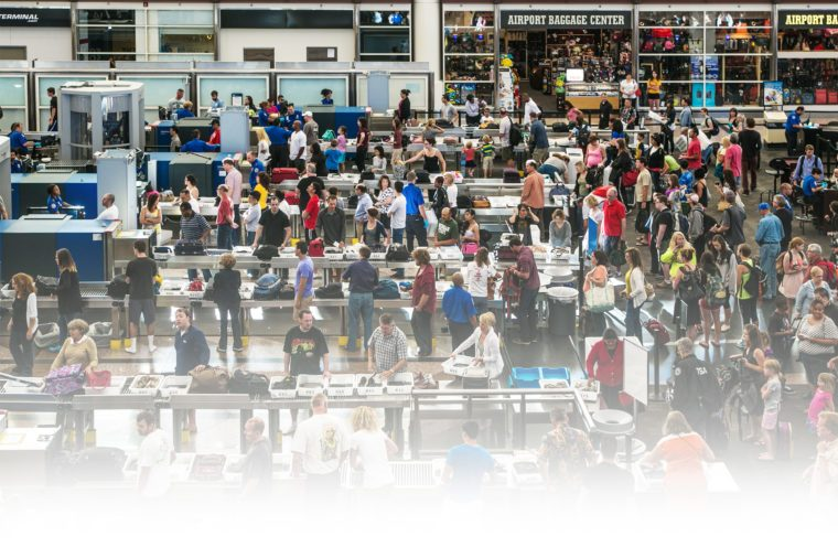 The TSA security lines in the main terminal are crowded with vacation travelers on June 16, 2013, in Denver, Colorado.
