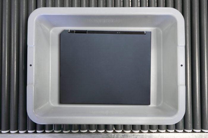 Notebook computer in an airport security bin