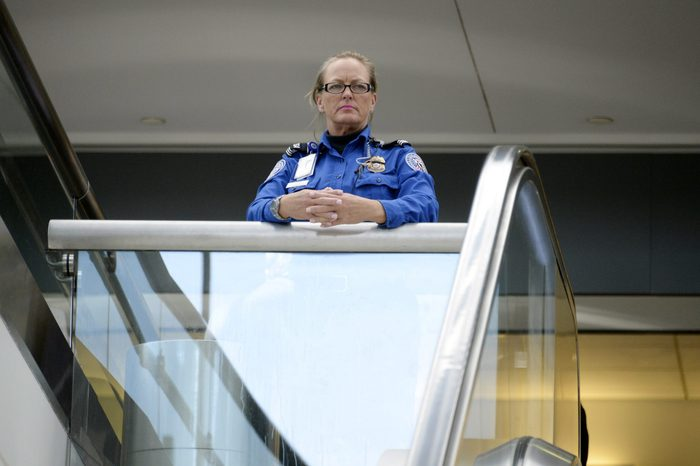 A Transportation Security Administration agent looks at travelers in Terminal 3 at Los Angeles International Airport November 2, 2013 in Los Angeles, California.