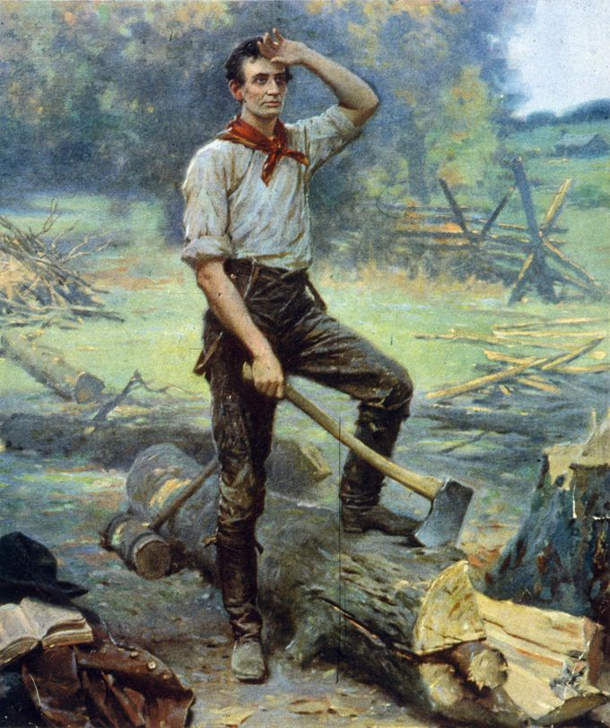 Abraham Lincoln at work cutting logs