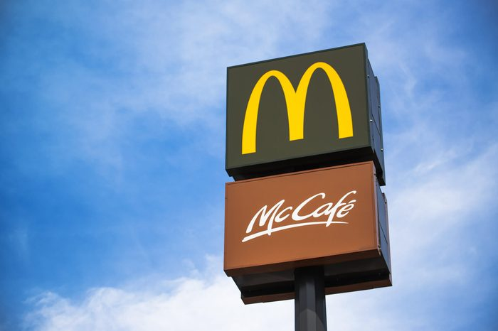 mcdonalds and mccafe signs against blue sky background