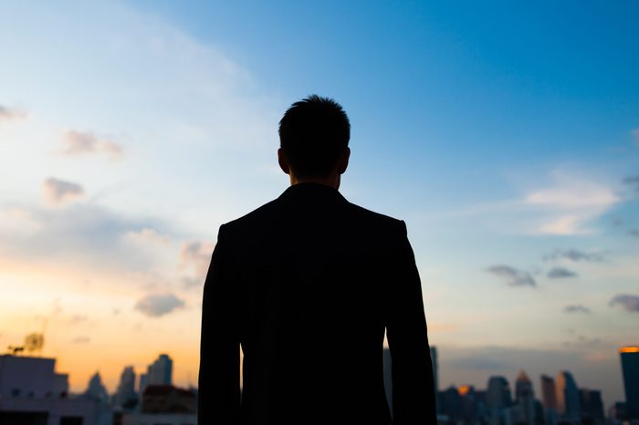 silhouette of a man. city and sky background.