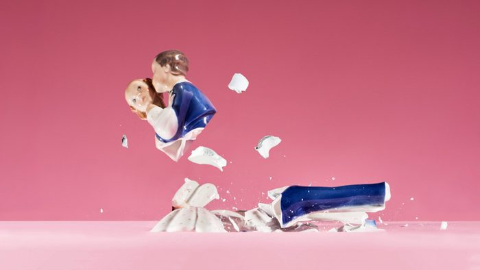 wedding statue smashed on pink background