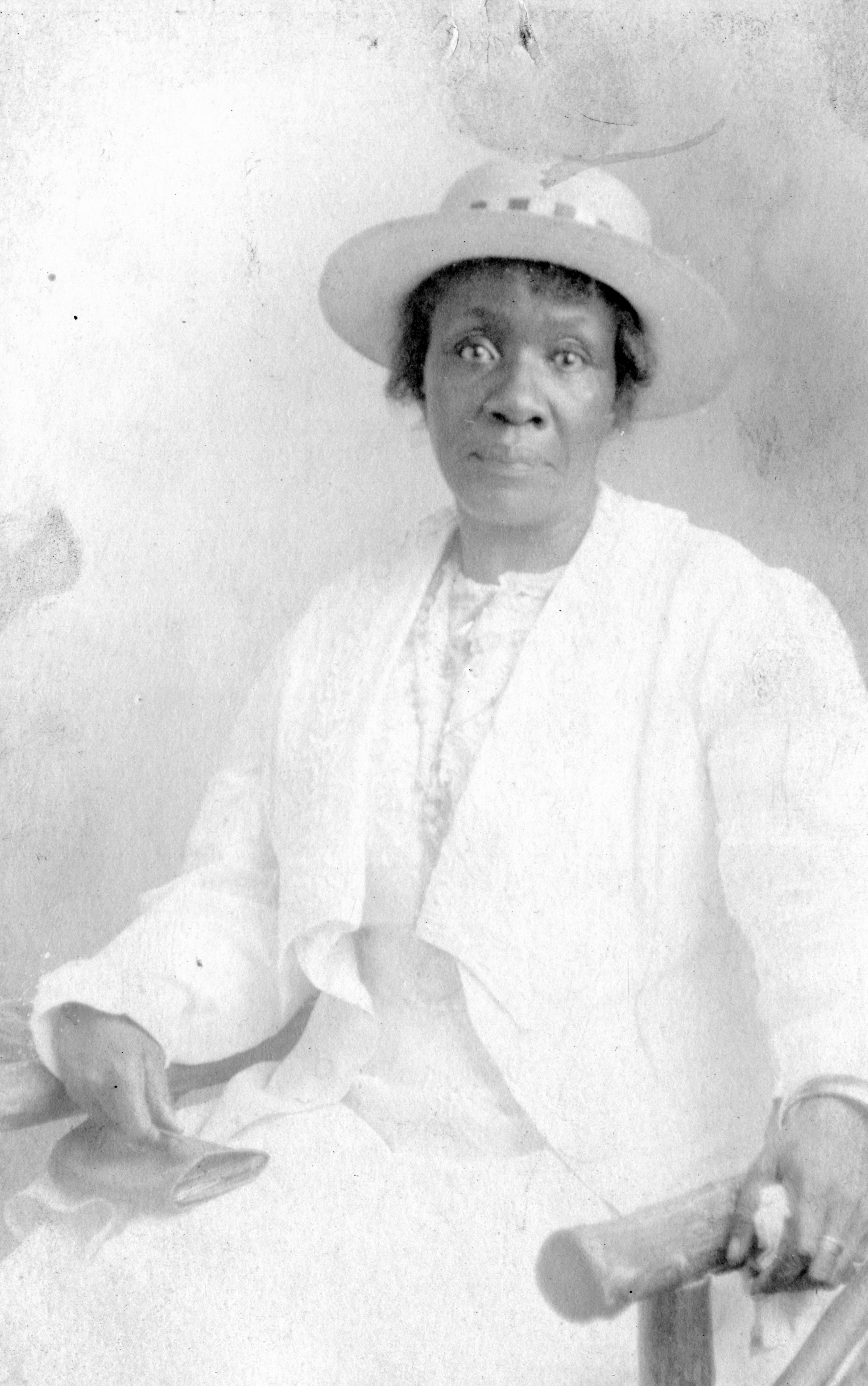 African-American mature woman wearing hat and formal dress fashion vintage 1920s
