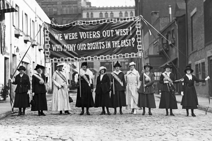 Suffragettes displaying banners at Washington Mews in Greenwich Village, New York City, ca. 1912.