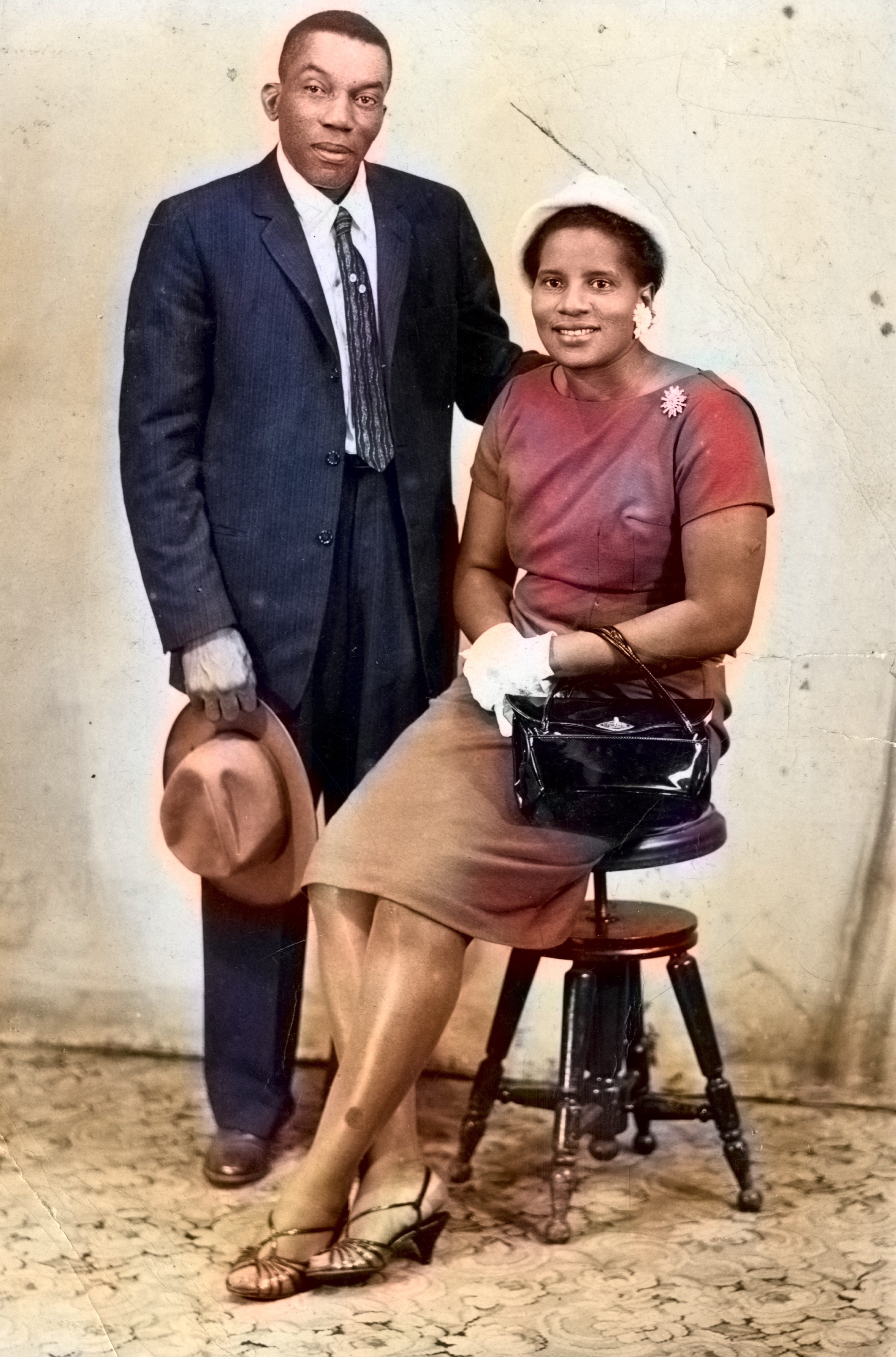 Portrait of African-American couple wearing hat, suit and formal dress, vintage fashion 1920s