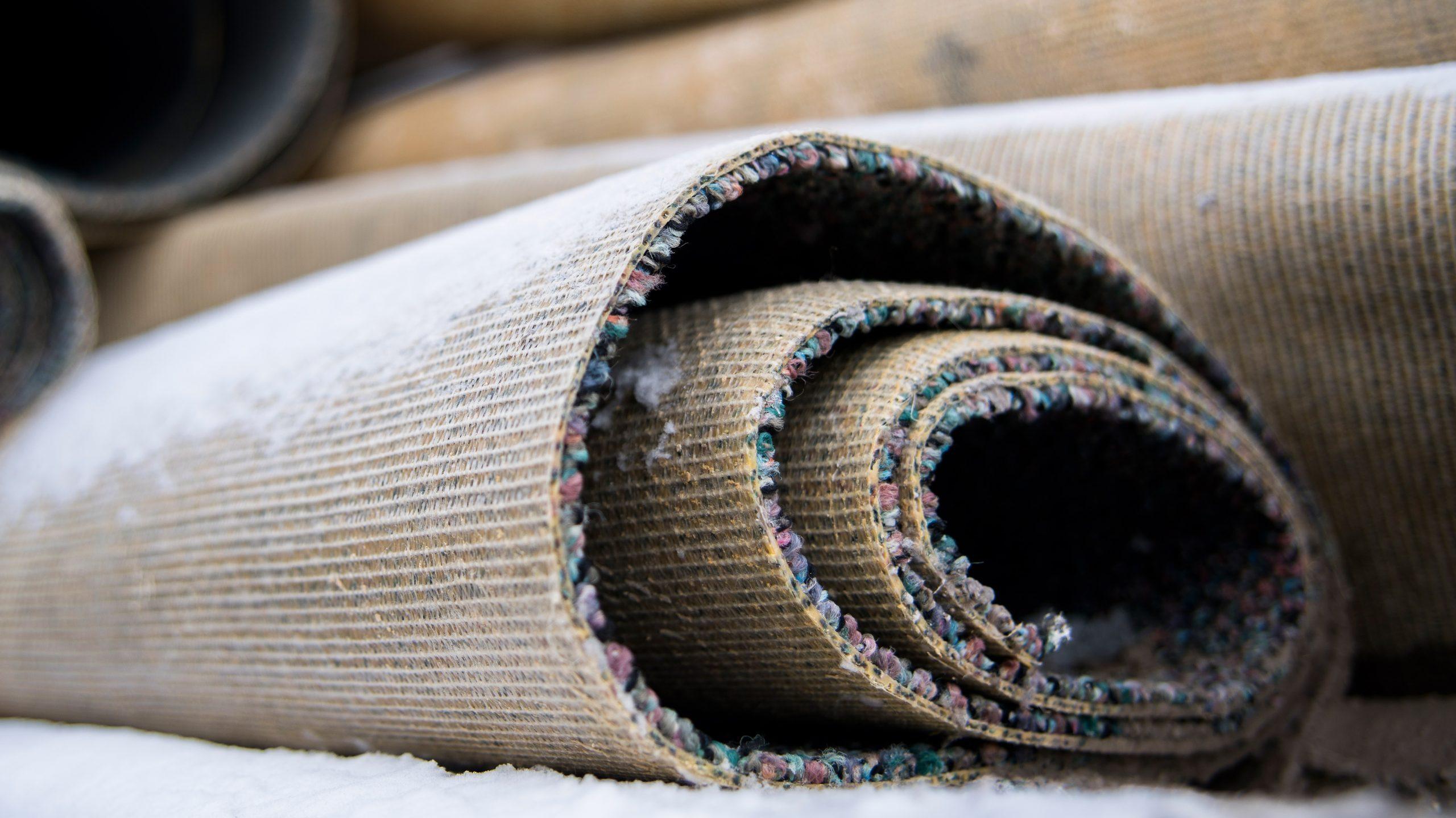 carpet scraps rolled up