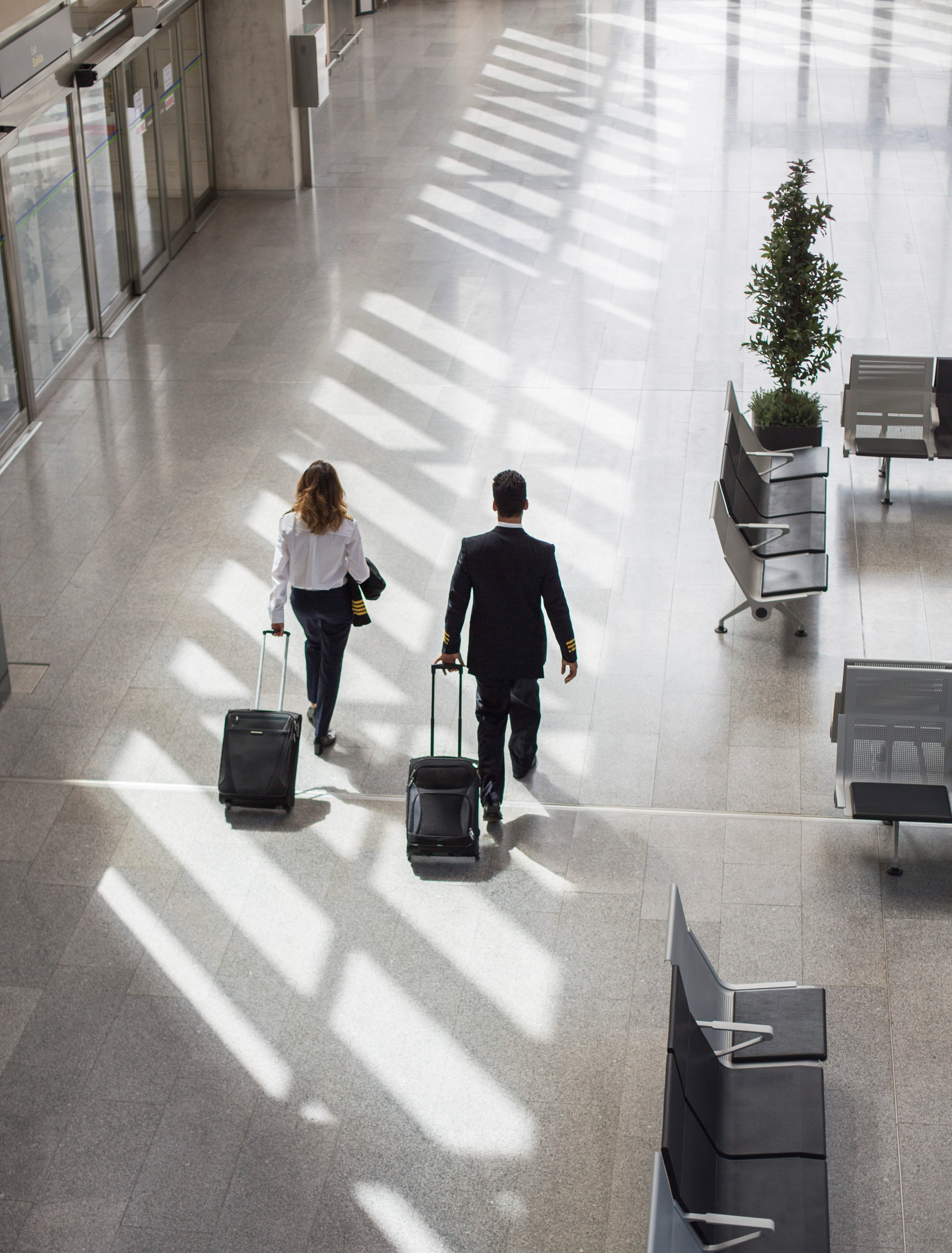 Captain, pilot, airport building soft-sided luggage