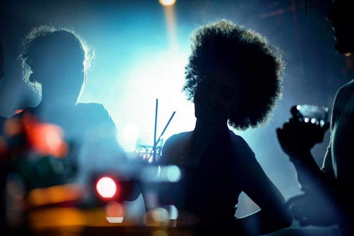 Silhouettes of people in the club while dancing and having fun at their night out.