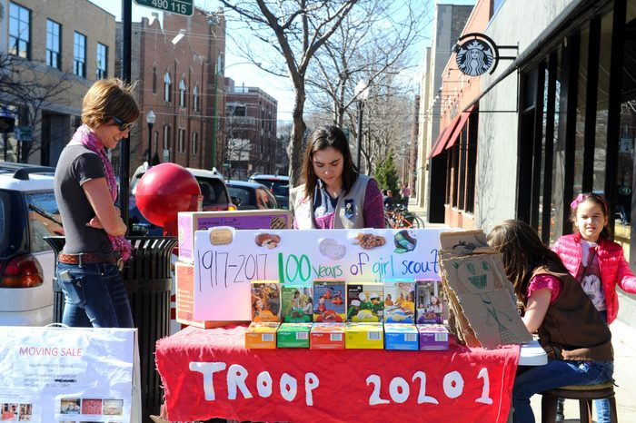 girl scout selling girl scout cookies