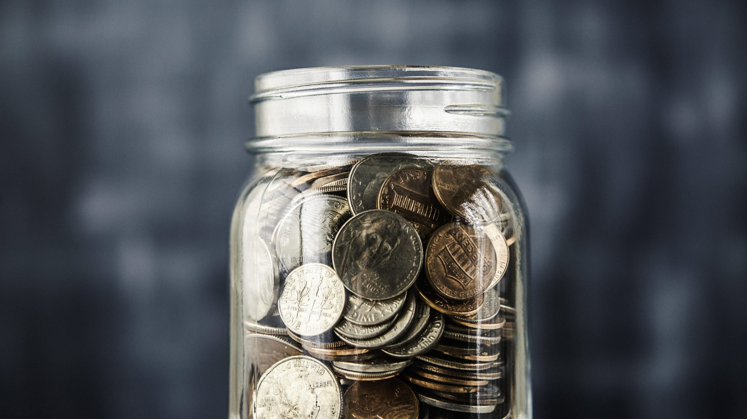 Savings jar filled with coins