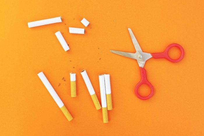 cigarettes cut up on a orange background