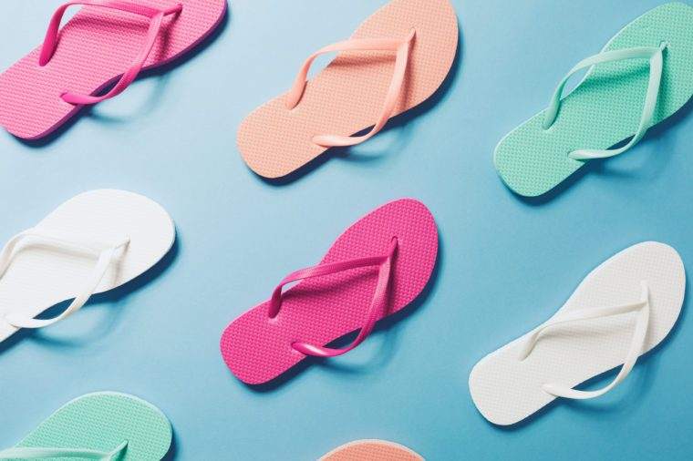 Overhead view of flip flops on the blue background.