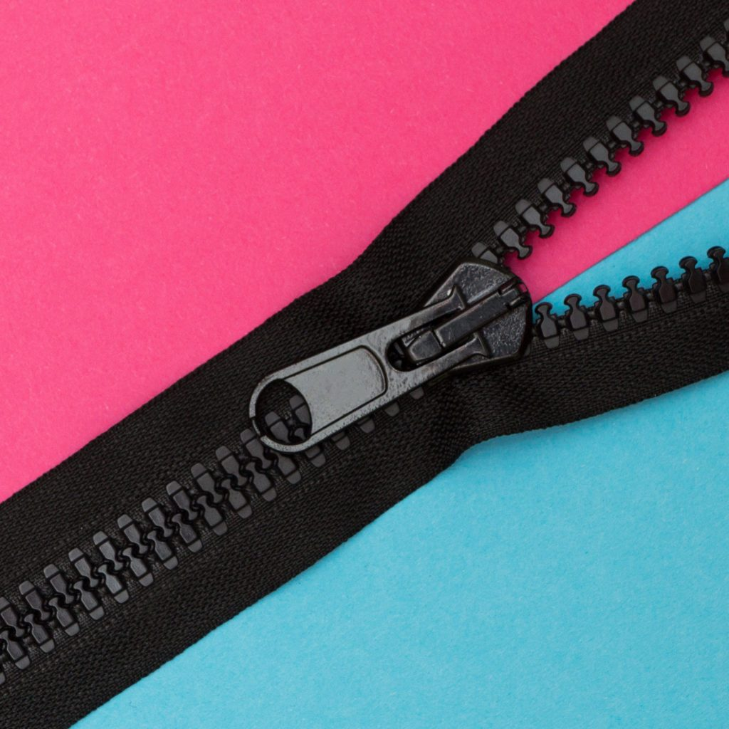 black zipper on pink and blue background