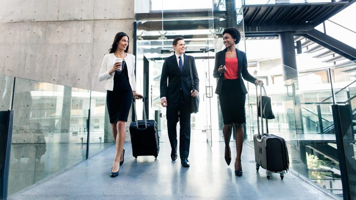 business people walking with suitcases and luggage