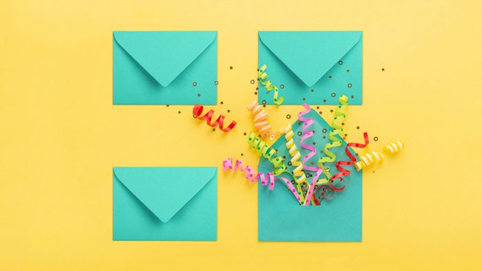 four envelopes on yellow background. fourth envelope (lower right) is open with confetti popping out.