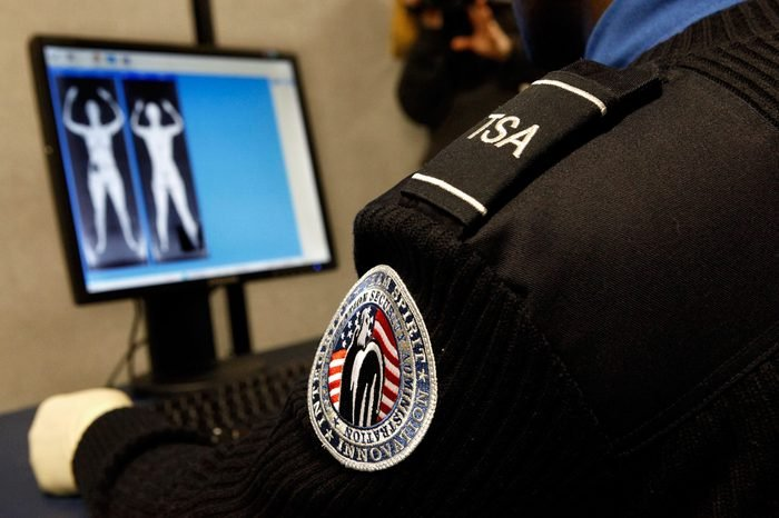 """Transportation Security Administration Security Officer Nyamsi Tchapleu looks at images created by a """"backscatter"""" scanner during a demonstration at the Transportation Security Administration's Systems Integration Facility at Ronald Reagan National Airport December 30, 2009 in Arlington, Virginia."""
