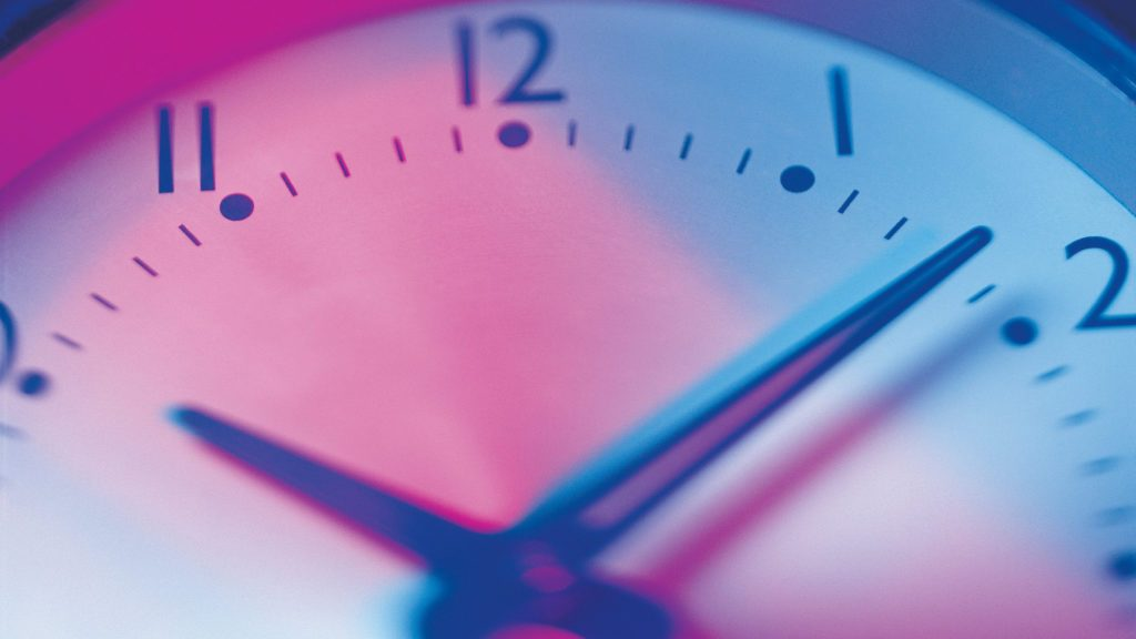 clock close up with blue and pink light