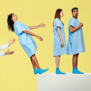 patients in line to trust fall into doctor's arms on yellow background
