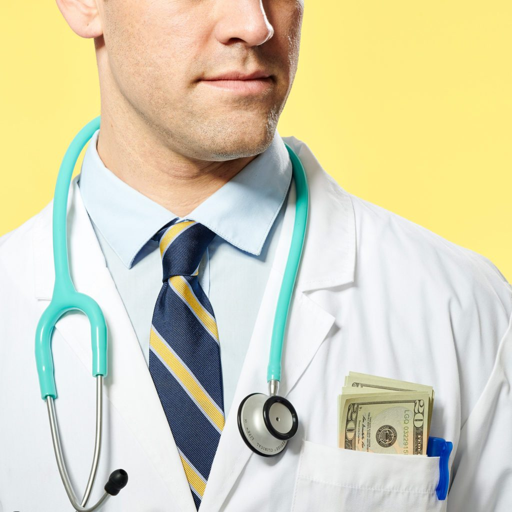 close up of doctor with money sticking out of his chest pocket. yellow background.