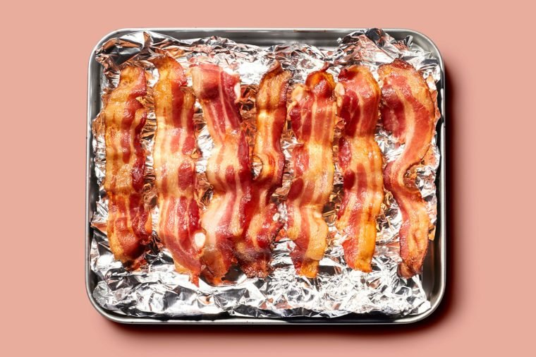 strips of bacon on tinfoil on oven tray