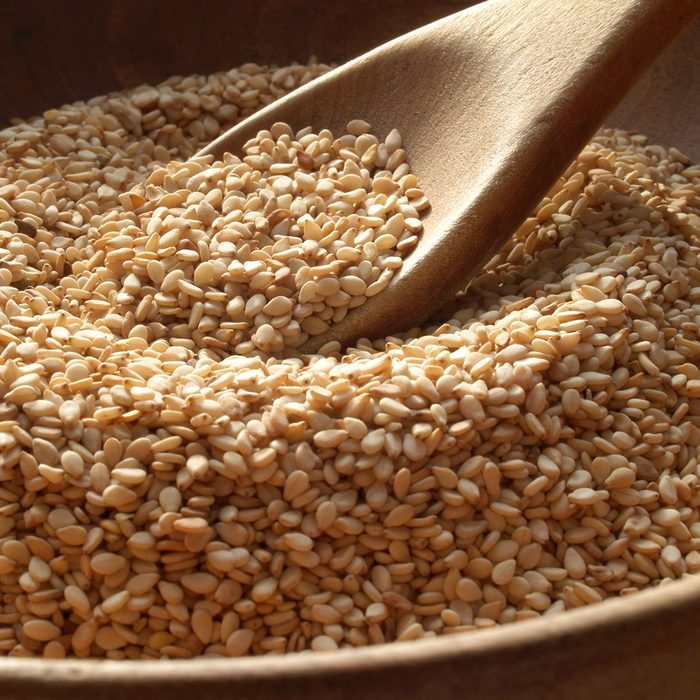 Wooden bowl of sesame seeds