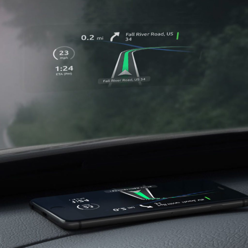 HUDWAY Go app in heads-up display mode. phone on a dashboard displaying directions on the windshield.