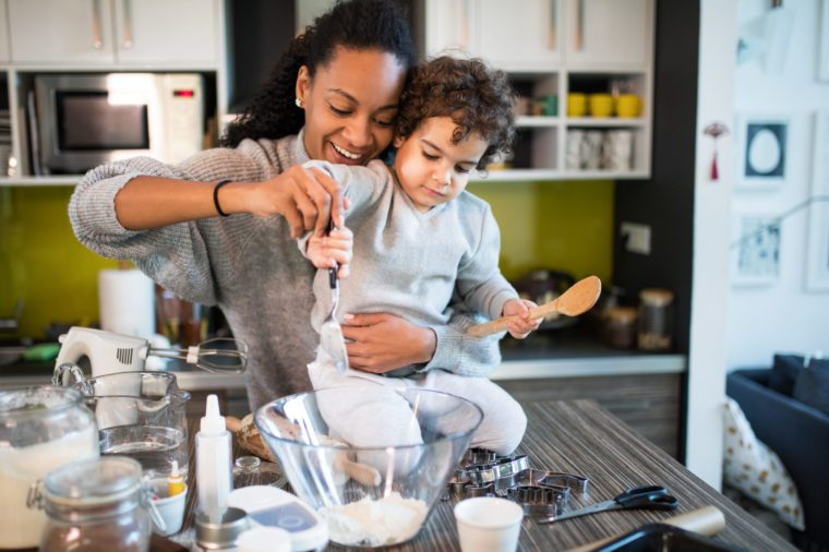 mother and cute young son baking in the kitchen