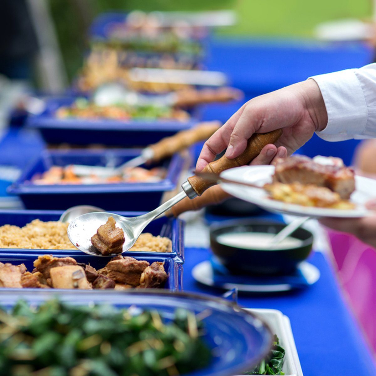 group in the line catering buffet food indoor in luxury restaurant with meat colorful rice and vegetables