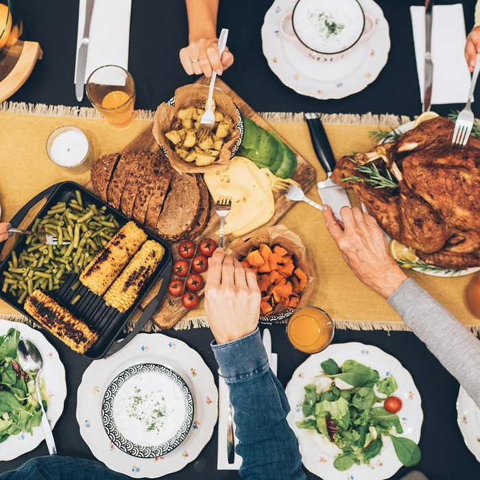 Overhead view of big family eating from table during Christmas dinner