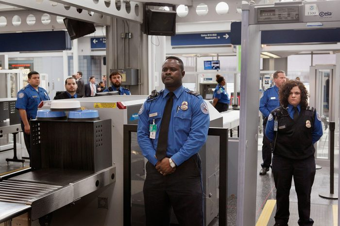 Transportation Security Administration (TSA) officers staff a checkpoint at O'Hare International Airport on March 15, 2010 in Chicago, Illinois.