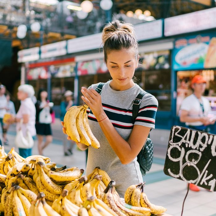 Tourist woman in Budapest buying fresh fruits