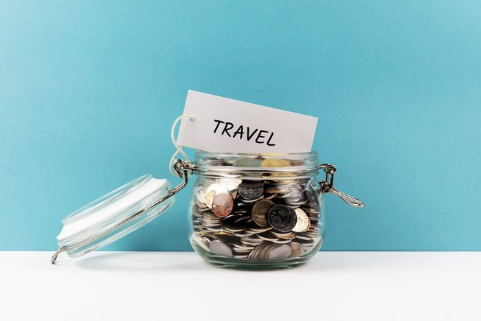 Travel Coin Jar On Blue Colored Background