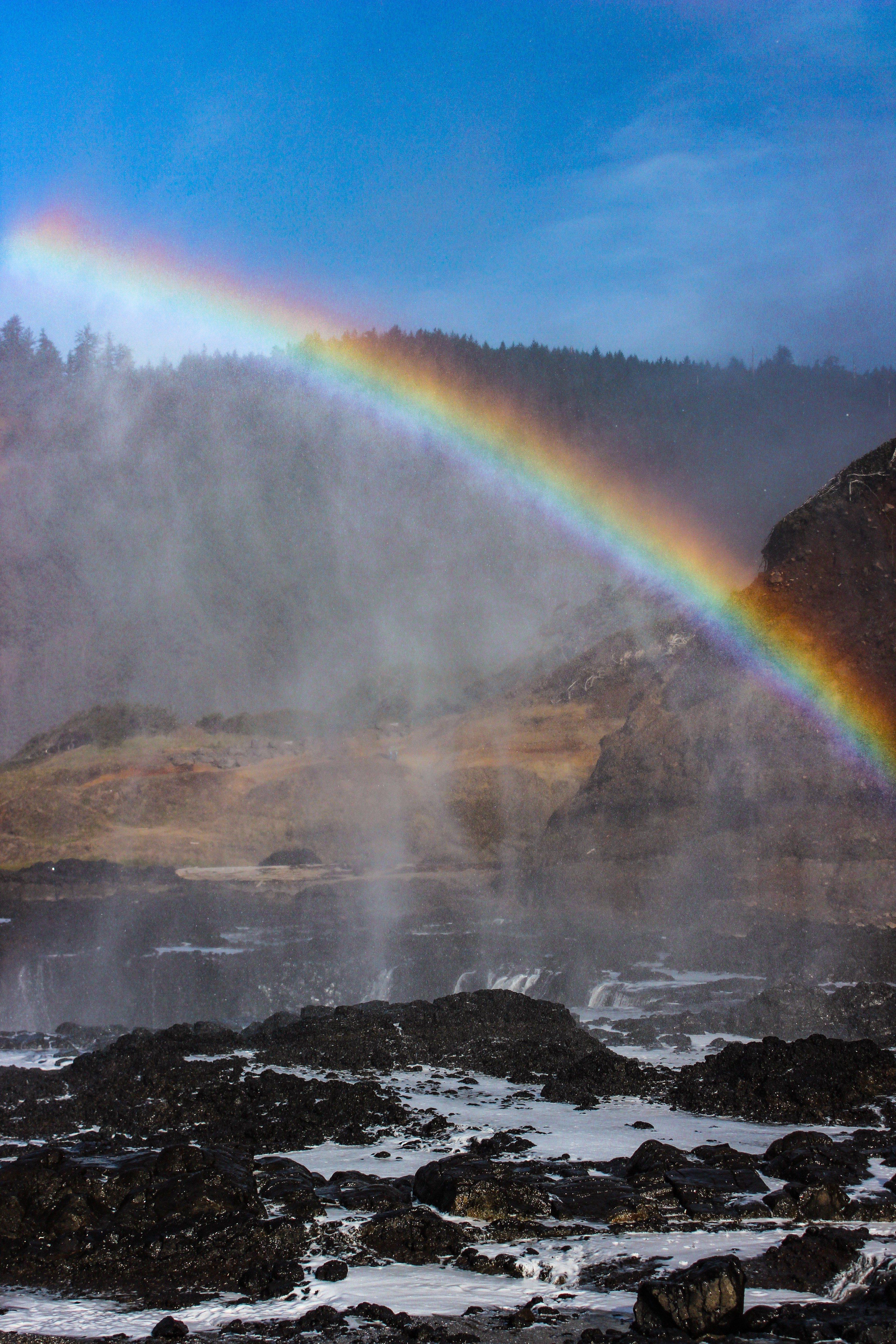 Devil's Punchbowl on the Oregon coast rainbow