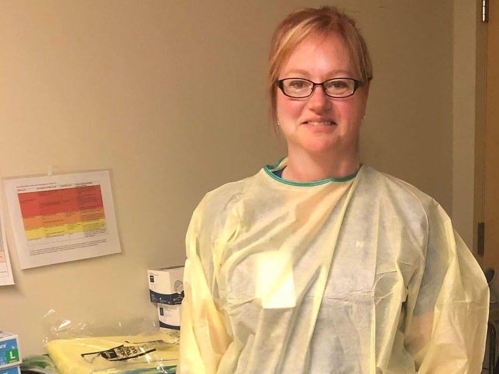 Ontario ER nurse Cynthia Rennie-Faubert stands in her scrubs