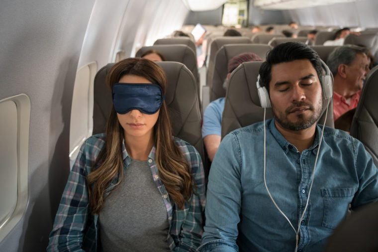 People traveling by air and sleeping on the plane