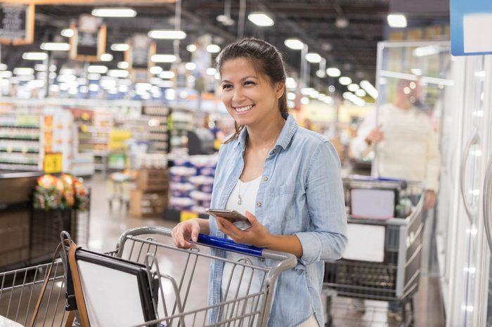 Woman enjoys shopping in bulk foods warehouse