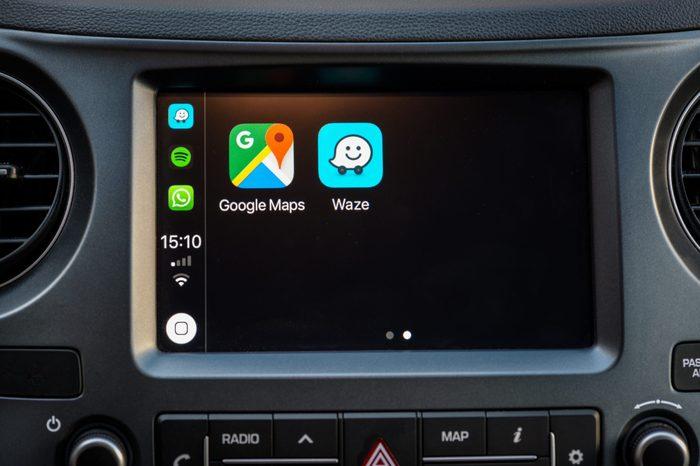 Apple Carplay screen in car dashboard displaying Google Maps and Waze apps