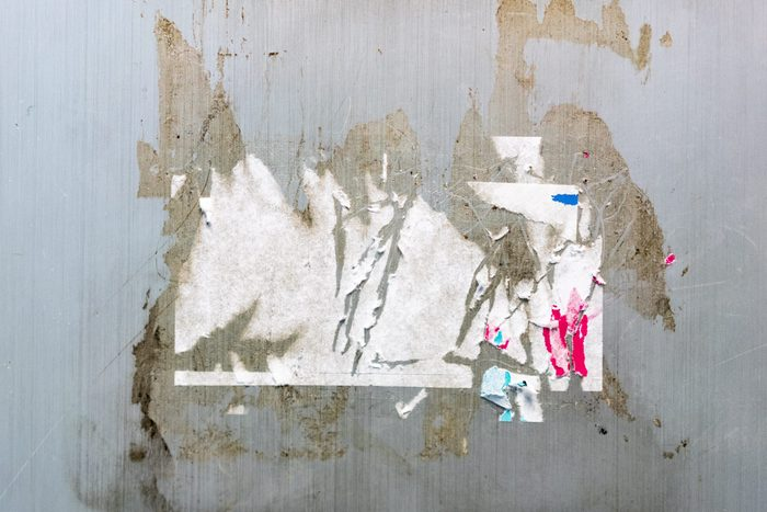 Sticker trace and glue trace on grey wall texture. Perfect for background.