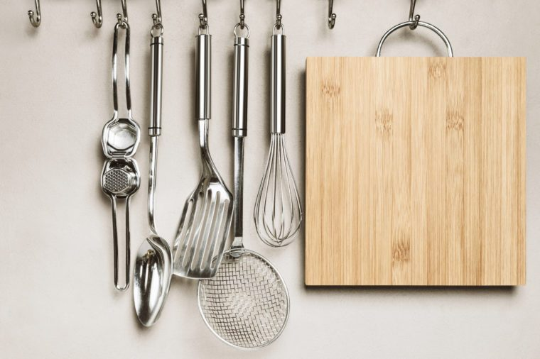 Close-up of kitchen items, wall on background