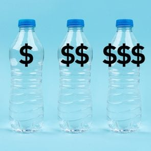 three plastic water bottles with