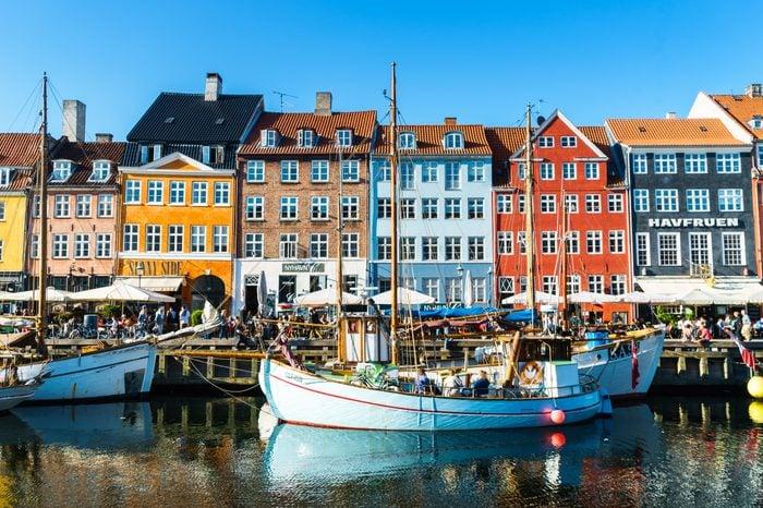 Copenhagen Nyhavn panorama city crowds enjoying sunshine restaurants bars Denmark