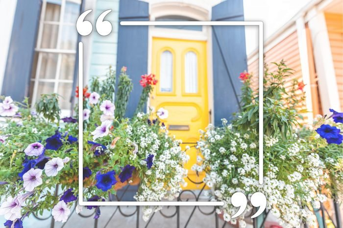 new orleans yellow front door with flowers on the gate. quotation marks frame overlay.