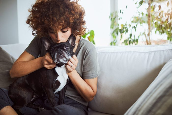 One woman taking good care of her french bulldog.