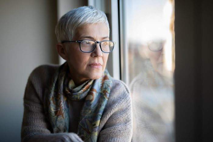 Portrait of beautiful mature woman relaxing by the window