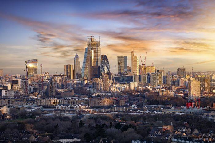 Sunrise over the urban skyline of the City of London, UK