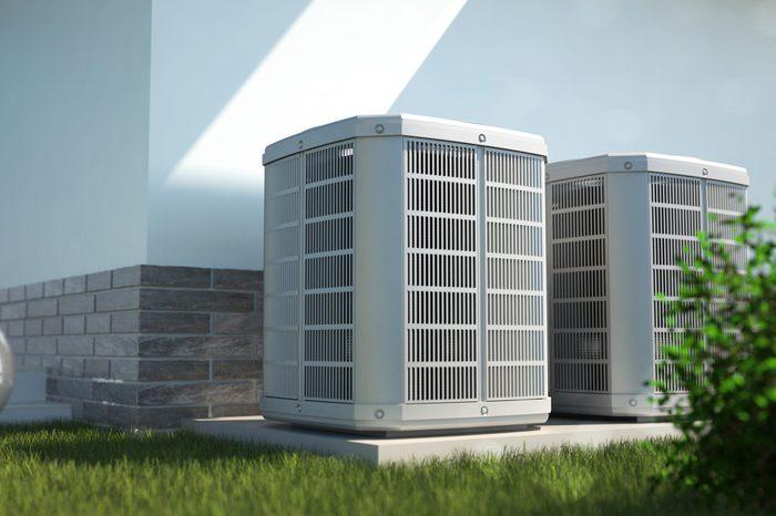 Air heat pumps beside house
